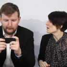 Graham is distracted by playing games on his phone